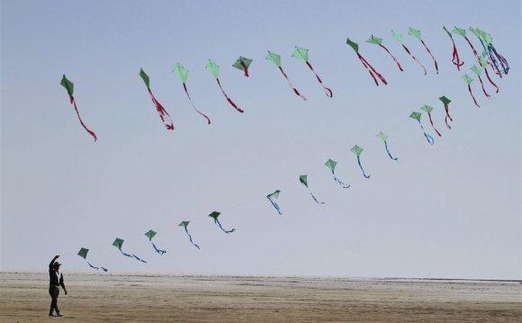 An Indian participant flies a