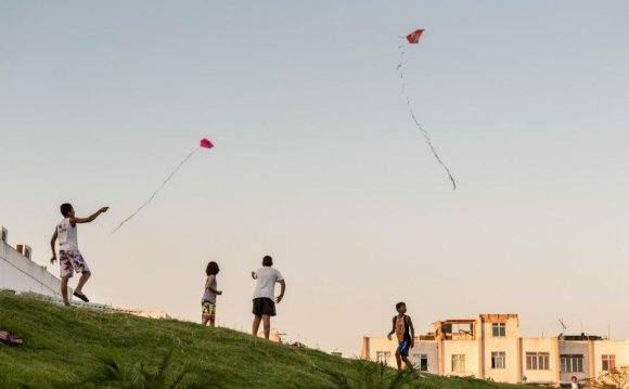 Local children flying kites