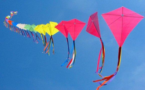 A rainbow-colored kite train