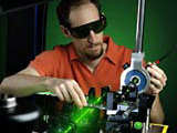 electrical engineer aligning laser
