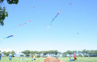 Families fly kites during Chinese Kite Festival at Ka'anapali North Beach