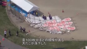 The huge kite hit nose first and then toppled onto a crowd of spectators watching the festival on a windy day in Higashiomi.