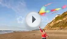 Girl Flying Kite At Beach